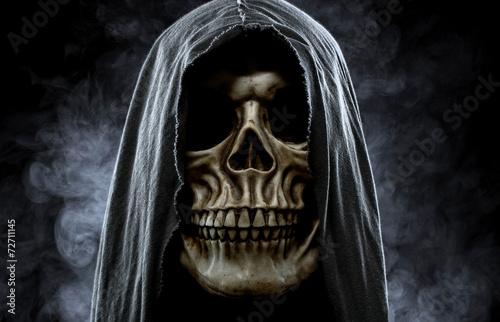 Grim reaper, portrait of a skull in the hood over black, foggy b - 72711145