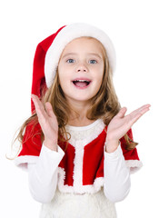 Surprised cute little girl in santa hat isolated