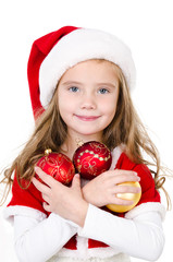 Smiling cute little girl with christmas balls