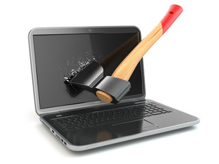 Laptop damaged by axe. Concept of anger when working at the comp