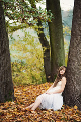 Pretty girl in the ballet skirt  relaxing in the autumn park