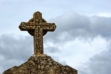 Stone cross on gravestone a cemetery in France.