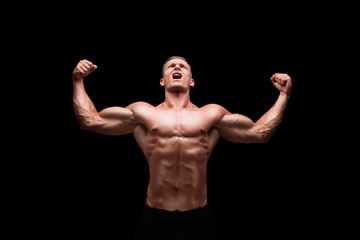 Male bodybuilder gesturing happiness