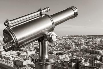 Shining retro metal telescope in Paris