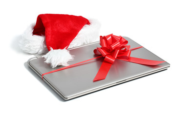 Laptop computer christmas gift with a ribbon