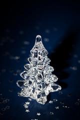 Christmas tree in spotlight on dark blue background