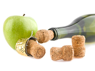 corks, apple and bottle of champagne