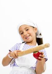 Small smiling chef with kitchen utensils and strawberry