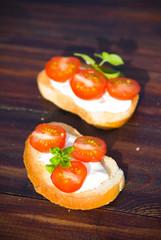 Italian tomato bruschetta with cheese and basilik