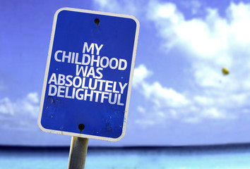 My Childhood Was Absolutely Delightful sign with a beach