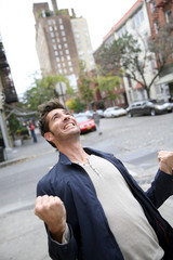 Man expressing happiness and screaming in the street