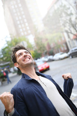 Man expressing happiness and success in the street