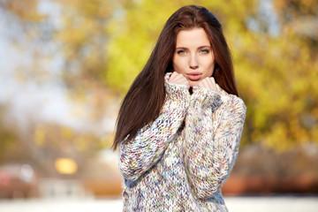 Pretty sensual woman enjoying outdoors in autumn day