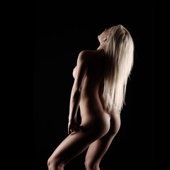 Perfect female body on dark background