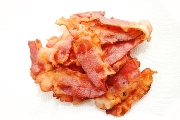 Crispy Fried Bacon Drying on Paper Towel