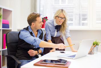 Man and female colleagues working together in the office
