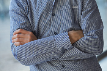 man in shirt folded his arms