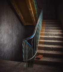 Vintage staircase and dirty floor in abandoned building interior