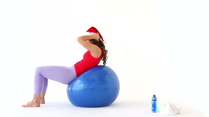 Fit festive brunette working out in santa hat