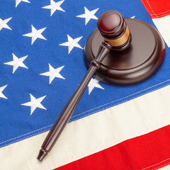 Neat judge gavel and soundboard over US flag
