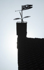 Silhouetted weathervane