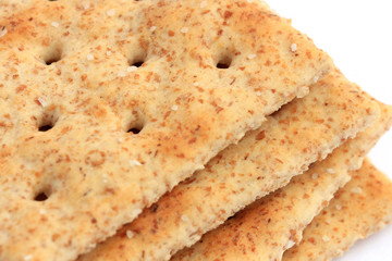 Extreme close-up of whole wheat saltine crackers