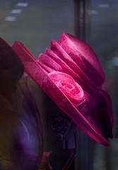 Elegant women's hat in a show-window of shop