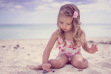 Cute baby girl at the beach