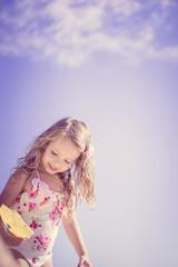 Cute baby girl at the beach