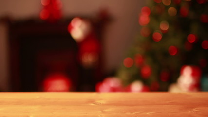 Empty table against blinking lights on christmas tree