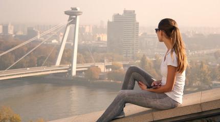 girl sitting over Bratislava