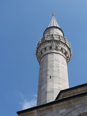 Single minaret of an ottoman Mosque in Istanbul
