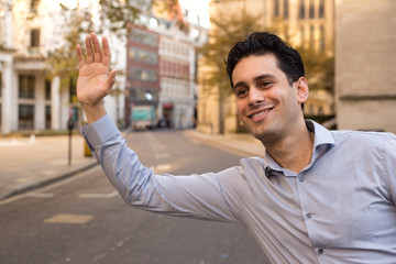 young man hailing a taxi.