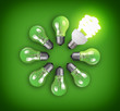 Idea concept with circle of light bulbs and glowing bulb