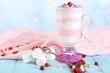 Leinwandbild Motiv Cranberry milk dessert in glass,