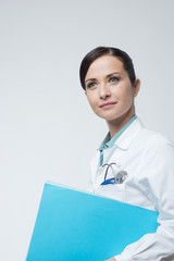 Smiling female doctor with file