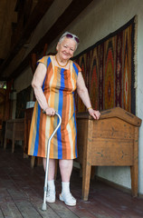 Smiling old woman with a cane
