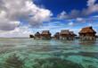 Lodges over transparent quiet sea water, Maldives