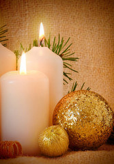 Christmas decoration and four white advent candles.