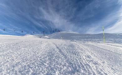 Skiing on groomed slope