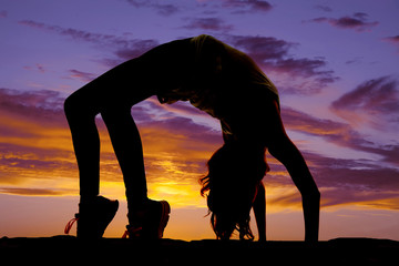 silhouette of woman doing back bend