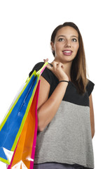 young girl smiling while doing shopping on white