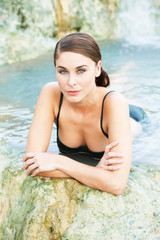 Young woman taking a bath in the natural thermal spa, Saturnia