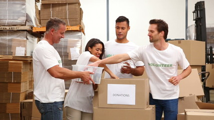 Warehouse workers packing up donation boxes