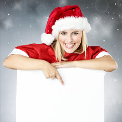 Woman with whiteboard for christmas