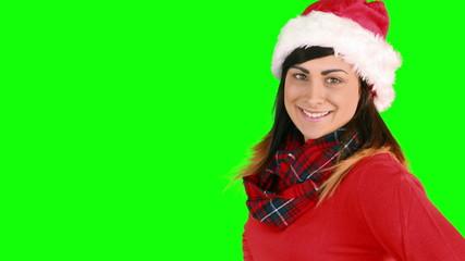 Festive brunette in santa hat blowing over hands