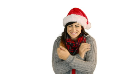 Woman in santa hat and warm clothing blowing over hands