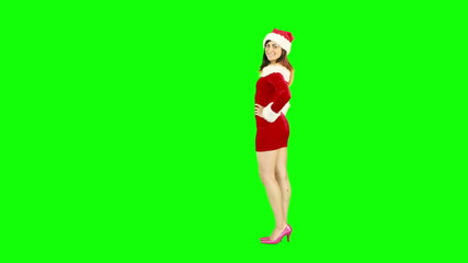 Pretty brunette in santa outfit blowing over hand