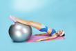 Abdominal Exercise. Sporty Woman with Fitness Ball