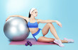 Repose. Woman with Sport Equipment - Fitness Ball, Dumbbells